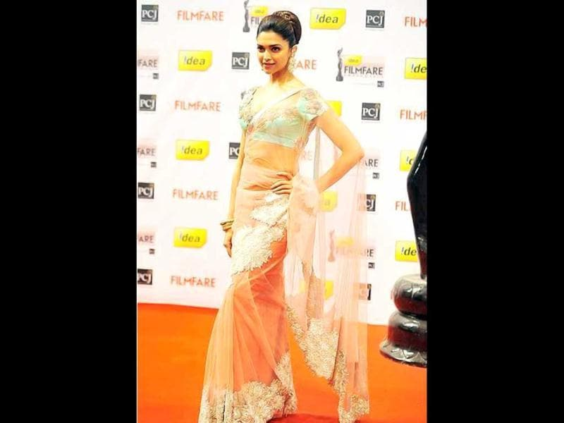 Deepika Padukone looks graceful in a sari.