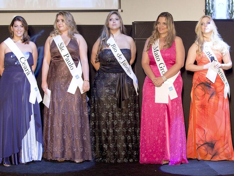 Contestants, (L-R) Larissa Rodrigues, Sylvia Barreto, Roberta Breves, Mirna Tardim, and Laila Gori, stand on the stage during the Miss Brazil Plus Size Beauty Pageant in Sao Paulo, Brazil. (AP Photo/Andre Penner)