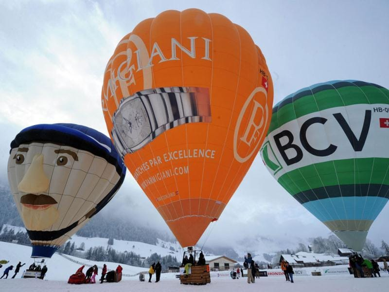 Hot air balloons take off in the Swiss Alps resort of Chateau d'Oex during the 34th International Balloon Festival. The world capital of the hot air ballon in the Alpine area welcomed some 100 balloons from 14 countries. AFP Photo / Yuri Kadobnov