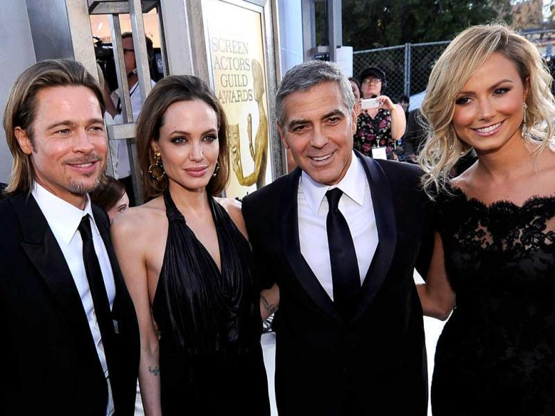 Brad Pitt, Angelina Jolie, George Clooney and Stacy Keiber pose together.