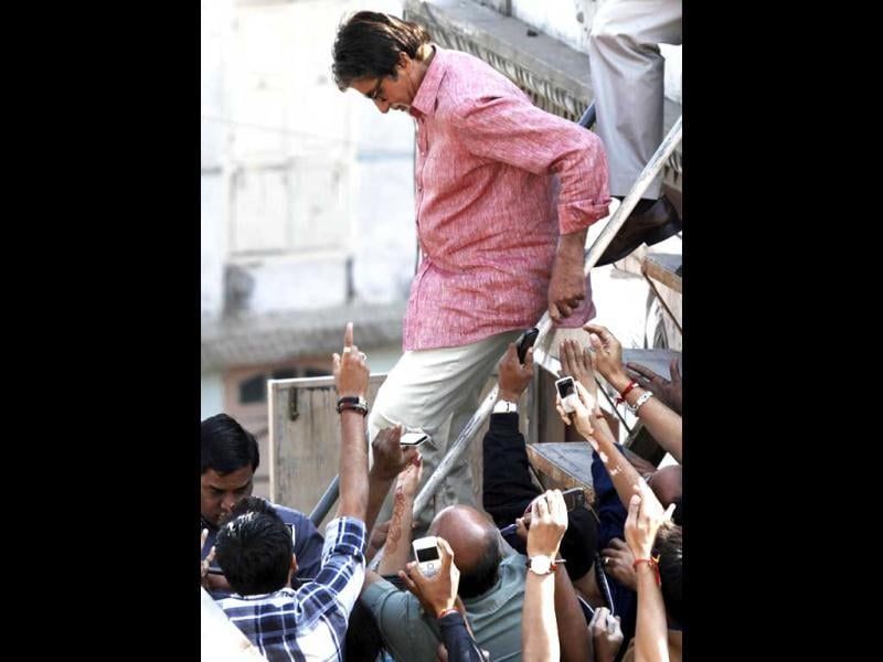 Fans use their mobile phones to take pictures of Bollywood actor Amitabh Bachchan in Ahmedabad.