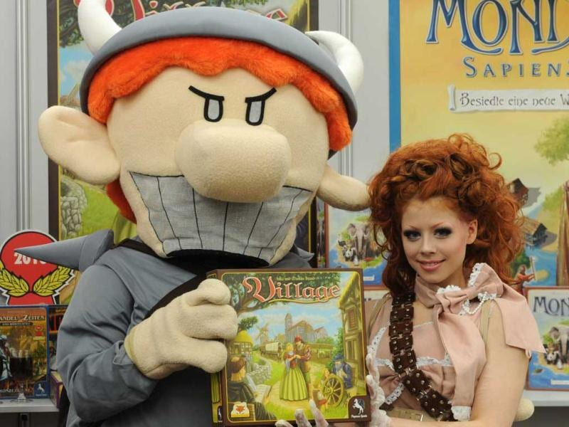 Models present the boardgame Village during the press preview of the international toy fair in Nuremberg, southern Germany. AFP
