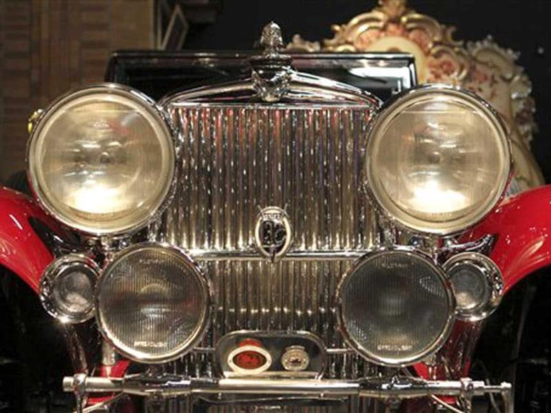 The front grille of a 1932 Stutz DV-32 Convertible Coupe sits on display at the Milhous Collection in Boca Raton, Florida. One of the America's most extraordinary and voluminous private collections of vintage cars, automated musical instruments and other memorabilia is going on the auction block. Brothers Bob Milhous and Paul Milhous will empty their 39,000-square-foot building, auctioning off its contents to bidders. The crown jewel is a custom-built carousel with 42 hand-carved animals, expected to fetch at least $1 million. All told, the auction is expected to generate about $40 million. (AP Photo/Alan Diaz)