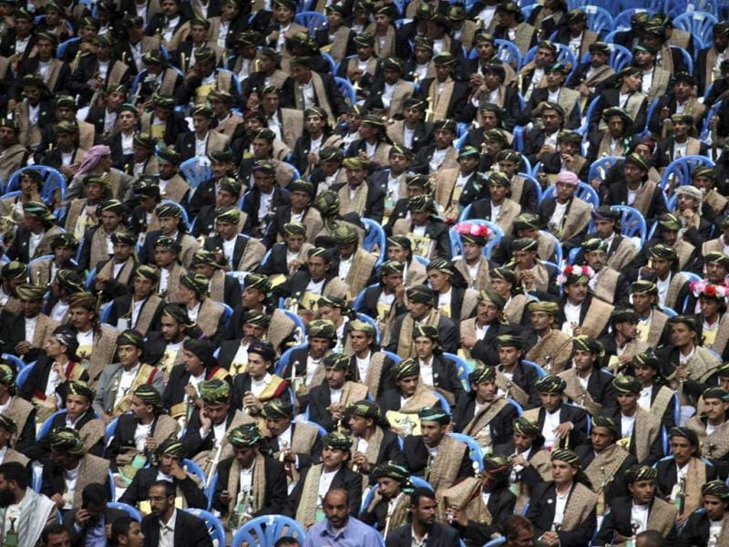 Bridegrooms attend a mass wedding ceremony in Sanaa. Some 3,200 brides and grooms were married in the wedding financed by Saudi Crown Prince Sultan Bin Abdul-Aziz. Reuters/Khaled Abdullah