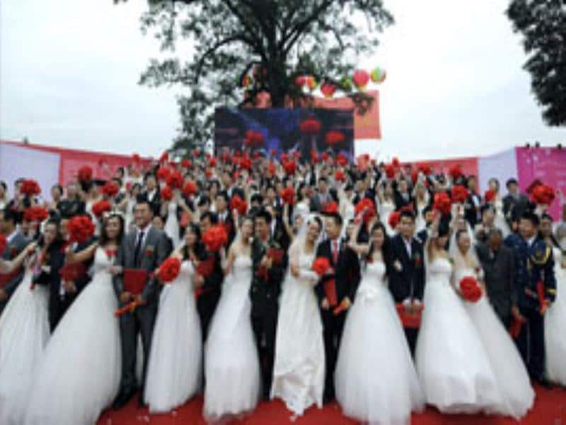 Couples pose for a group photograph during a mass wedding ceremony in Shifang, Sichuan province. The ceremony was held for some 99 couples from all over the nation, who have carried out relief work or donation after the 2008 Sichuan earthquake, according to local media. Reuters