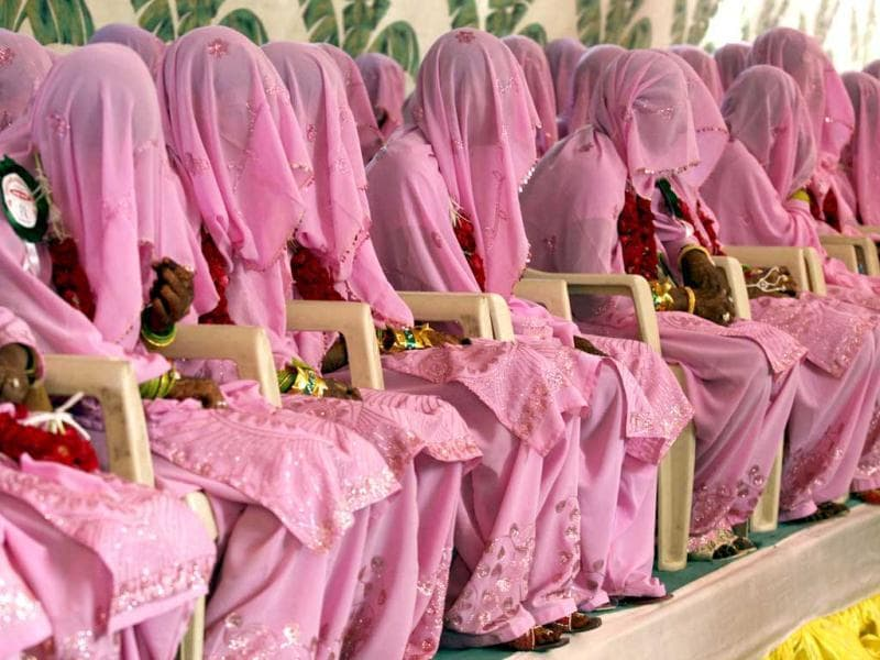 Muslim brides wait for their wedding ceremonies to start during a mass marriage ceremony in the western Indian city of Ahmedabad. Reuters/Amit Dave
