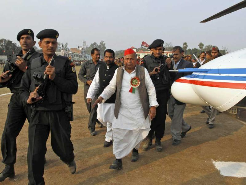 Samajwadi Party leader Mulayam Singh Yadav walks towards a chopper as he leaves after addressing an election rally in Allahabad. AP Photo/Rajesh Kumar Singh.