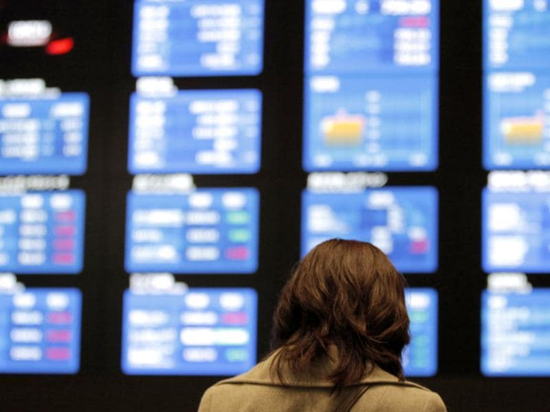 A woman checks the electronic stock board at the Tokyo Stock Exchange. AP Photo/Itsuo Inouye