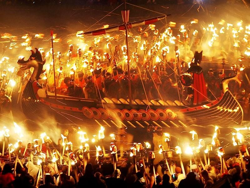 'Guizers' with flaming torches are pictured with a Viking Galley in Lerwick, on the Shetland Isles, off the north-east coast of Scotland, during the Up Helly Aa Viking festival (AP Photo/Danny Lawson)
