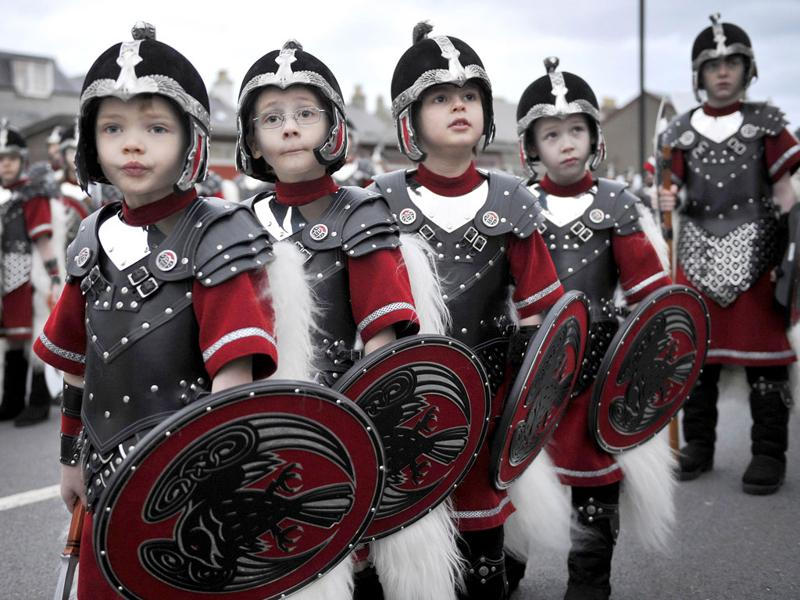 Boys take part in a Viking procession during the annual Up Helly Aa festival in Lerwick, Shetland Islands. (AFP PHOTO/Andy Buchanan)
