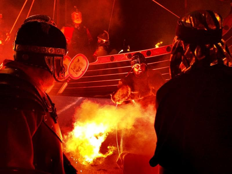 Members of the Jarl Squad are pictured in front of a burning Viking Galley in Lerwick, on the Shetland Isles, off the north-east coast of Scotland, during the Up Helly Aa Viking festival. (AP Photo/Danny Lawson)