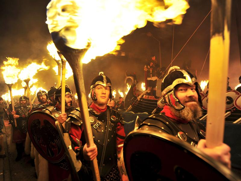 Participants dressed in armour and holding Viking war-axes and shields take part in a procession during the annual Up Helly Aa festival in Lerwick, Shetland Islands. (AFP PHOTO/Andy Buchanan)