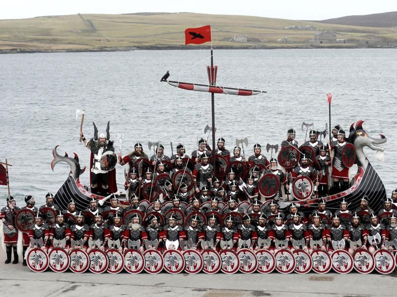 Participants dressed as Vikings pose beside their longboat during the annual Up Helly Aa festival in Lerwick, Shetland Islands. Up Helly Aa celebrates the influence of the Scandinavian Vikings in the Shetland Islands and culminates with up to 1,000 'guizers' (men in costume) throwing flaming torches into their Viking longboat and setting it alight later in the evening. (AFP PHOTO/Andy Buchanan)