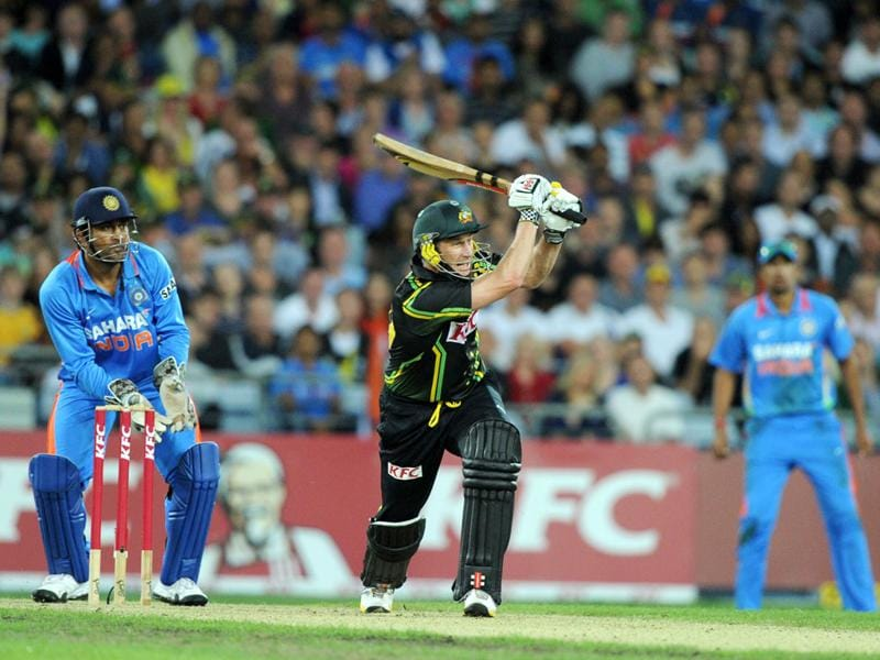 Australia's David Hussey hits out against India during the Twenty20 cricket match in Sydney. AFP Photo/Greg Wood
