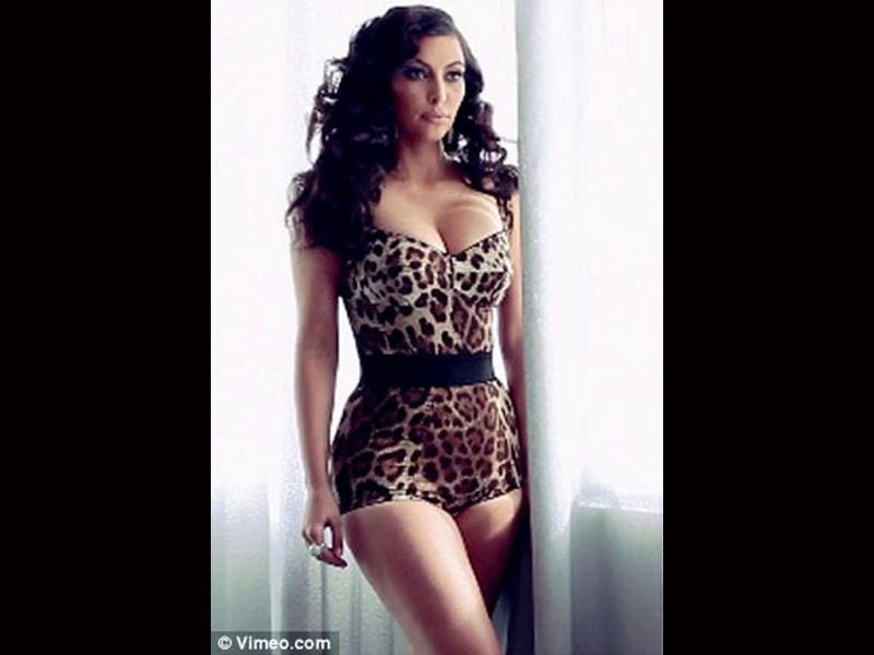 Animal rights: Kim poses in a leopard print one-piece.