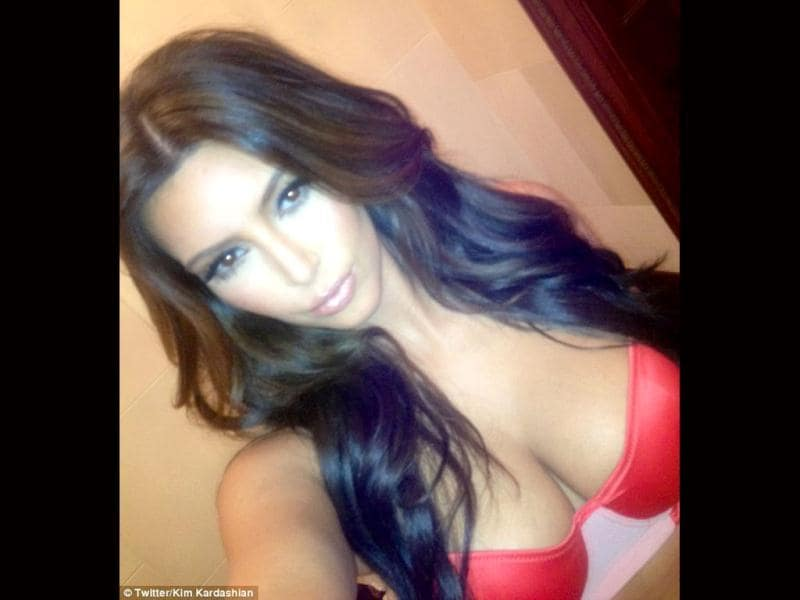 Look at me: Kim Kardashian tweeted this picture of her new hair colour, but is anyone really looking at her hair?
