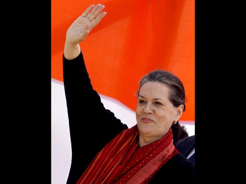 Congress party President Sonia Gandhi waves to supporters during an election campaign rally in Gonda, Uttar Pradesh. The state goes to the polls from February 8. AP/Rajesh Kumar Singh