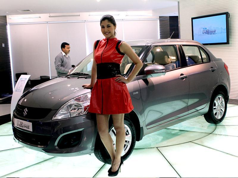 A model poses with the newly unveiled Swift DZire in New Delhi. HT/Sunil Saxena