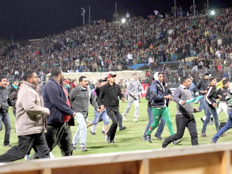 Egyptian fans rush into the field following Al-Ahly club soccer match against Al-Masry club at the soccer stadium in Port Said, Egypt. Dozens of Egyptians were killed Wednesday in violence following a soccer match in Port Said, when fans flooded the field seconds after a match against a rival team was over, Egypt's Health ministry said. (AP Photo)