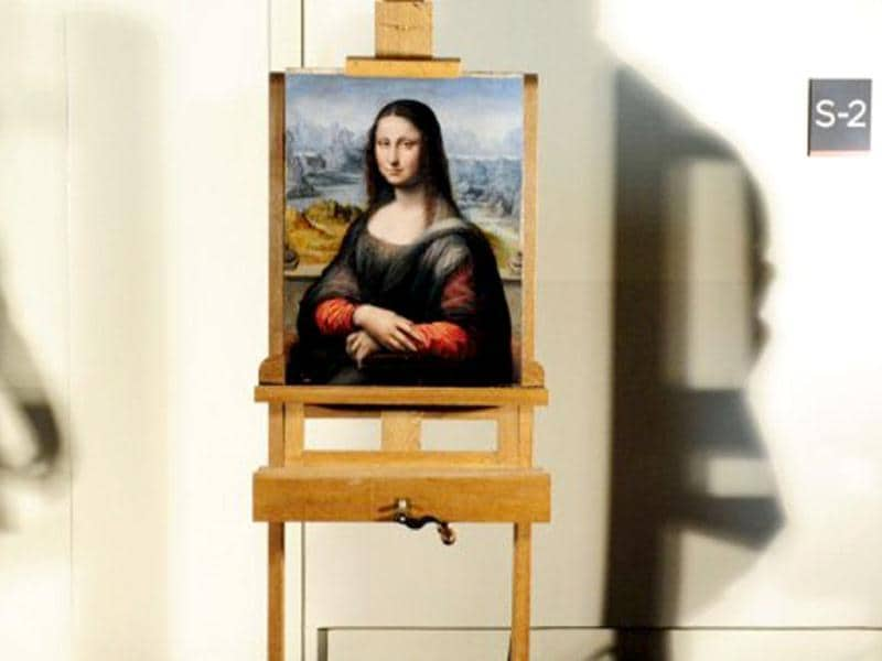 View of an authenticated contemporary copy of Leonardo da Vinci's Mona Lisa presented at the Prado Museum after it was found in its vaults. According to details of experts' findings published by the specialist British journal The Art Newspaper and the Spanish media, the work is a copy painted in Da Vinci's studio by one of his pupils. AFP Photo / Javier Soriano