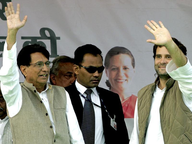 Rahul Gandhi, right, and Rashtriya Lok Dal leader Ajit Singh wave as they arrive for an election rally in Meerut. AP Photo