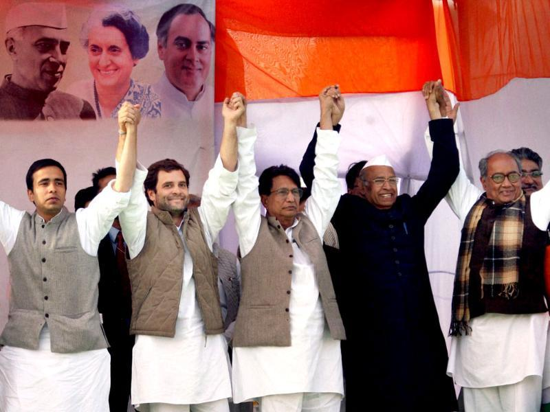 Congress general secretary Rahul Gandhi, Union minister and Rashtriya Lok Dal (RLD) chief Ajit Singh, his son and party leader Jayant Chaudhary and Congress leader Digvijaya Singh (R) join hands at an election rally in Meerut. PTI Photo