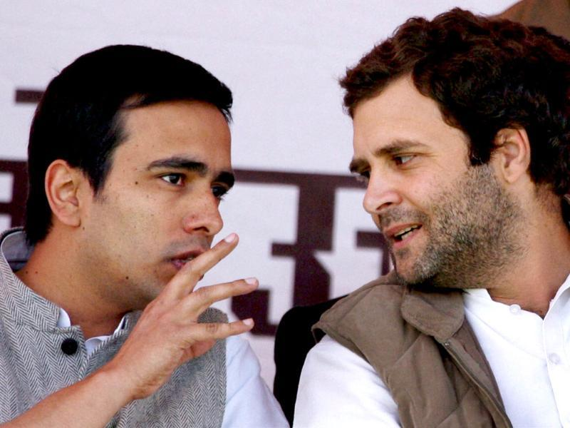 Congress general secretary Rahul Gandhi and Rashtriya Lok Dal (RLD) leader Jayant Chaudhary talk at an election rally in Meerut. PTI Photo