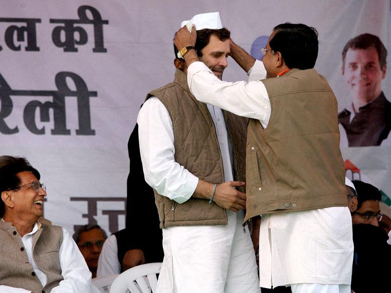 Congress general secretary Rahul Gandhi is presented a cap as Rashtriya Lok Dal chief Chaudhary Ajit Singh looks on at an election rally in Meerut. PTI Photo