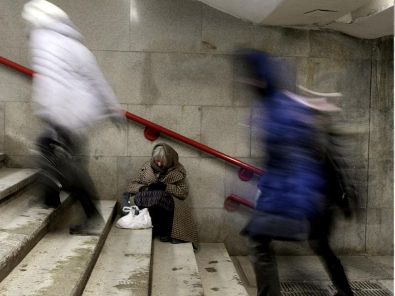 A woman begs for money in an underground passage, with the air temperature at about minus 24 degrees Celsius (minus 11.2 degrees Fahrenheit), in Minsk. Record-low temperatures in parts of Eastern Europe pushed the death toll from Arctic conditions to at least 89 people on Wednesday, and have forced Russian gas provider Gazprom to warn over supplies to Europe. Reuters/Vasily Fedosenko