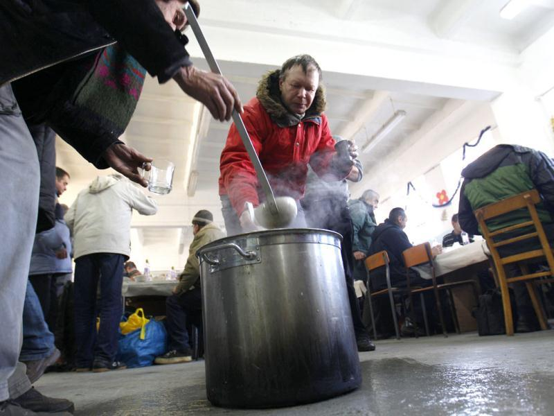 Homeless people help themselves to hot tea at a soup kitchen at Hospice of St. Cross in Warsaw. More than 60 people have died in a cold snap across Eastern Europe, authorities said on Tuesday, forcing some countries to call in the army to help secure food and medical supplies and set up emergency shelters for the homeless. The temperature in Ukraine sank to minus 33 degrees Celsius (minus 27 Fahrenheit), the coldest in six years, while eastern Bosnia experienced lows of minus 31 C (minus 24 F) and Poland, Romania and Bulgaria minus 30 C (minus 22 F). Reuters/Peter Andrews