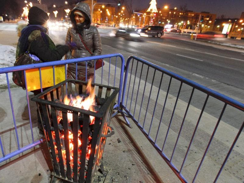 Two women stand next to a coal heater at a bus stop on Plac na Rozdrozu in Warsaw. More than 60 people have died in a cold snap across Eastern Europe, authorities said, forcing some countries to call in the army to help secure food and medical supplies and set up emergency shelters for the homeless. The temperature in Ukraine sank to minus 33 degrees Celsius (minus 27 Fahrenheit), the coldest in six years, while eastern Bosnia experienced lows of minus 31 C (minus 24 F) and Poland, Romania and Bulgaria minus 30 C (minus 22 F). Reuters/Peter Andrews