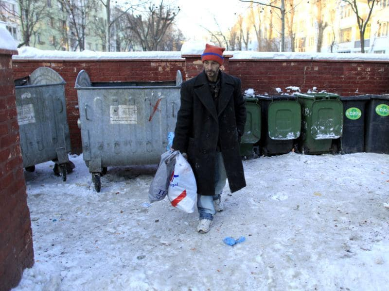 Homeless man Aurel Zugravu, 42, who refused to go to a community shelter, leaves after picking through garbage bins in Bucharest. Local police and authorities are trying to relocate homeless people to community shelters where they can sleep and eat as temperatures dropped to as low as -30 degree Celsius in some parts of Romania where 14 people died in the snap cold. Record-low temperatures in parts of Eastern Europe pushed the death toll from Arctic conditions to at least 89 people on Wednesday, and have forced Russian gas provider Gazprom to warn over supplies to Europe. Reuters/Radu Sigheti