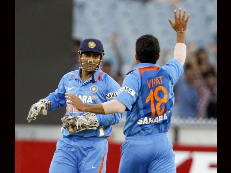 Virat Kohli (R) of India celebrates with compatriot Mahendra Singh Dhoni (L) after stumping Aaron Finch of Australia during their T20 International series cricket match at the Melbourne Cricket Ground in Melbourne.(Reuters/Brandon Malone)