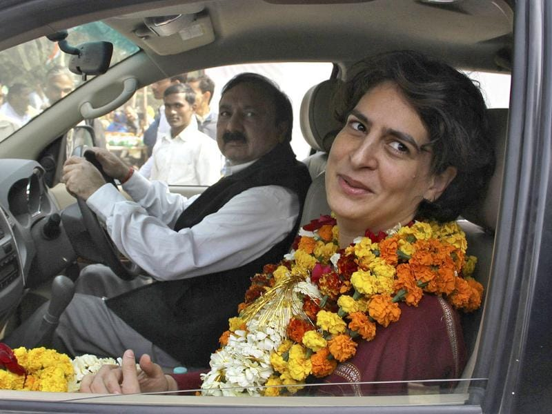 Priyanka Gandhi Vadra, wearing garlands of marigold flowers presented to her by the supporters of Congress party, departs after addressing an election campaign rally at Amethi in Uttar Pradesh. Reuters Photo