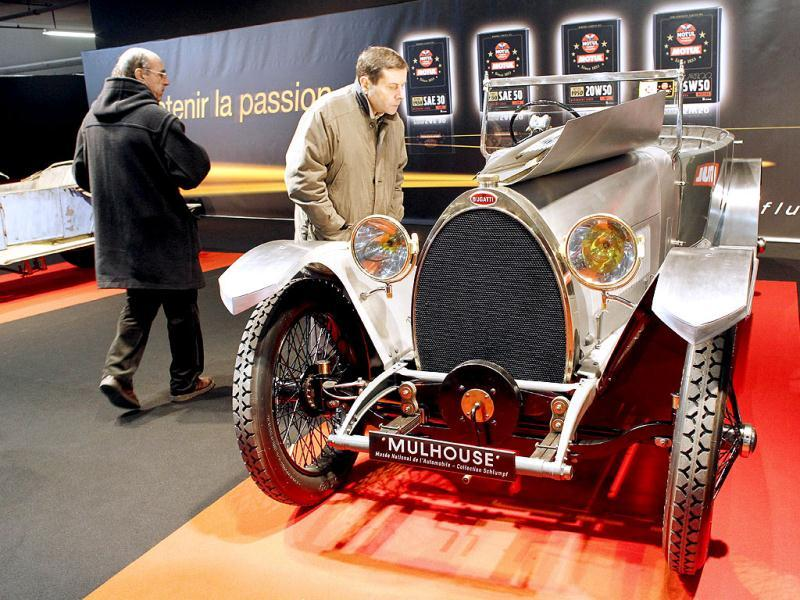 People look at a Bugatti type 28 torpedo prototype of 1921-1923 exhibited as part of the Paris Retromobile classic car show. AFP/Thomas Samson