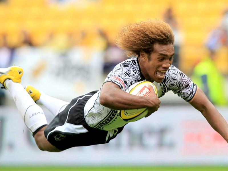 Fiji's Osea Kolinisau scores a try during day two of play at the Rugby Sevens tournament in Wellington. AFP/Marty Melville
