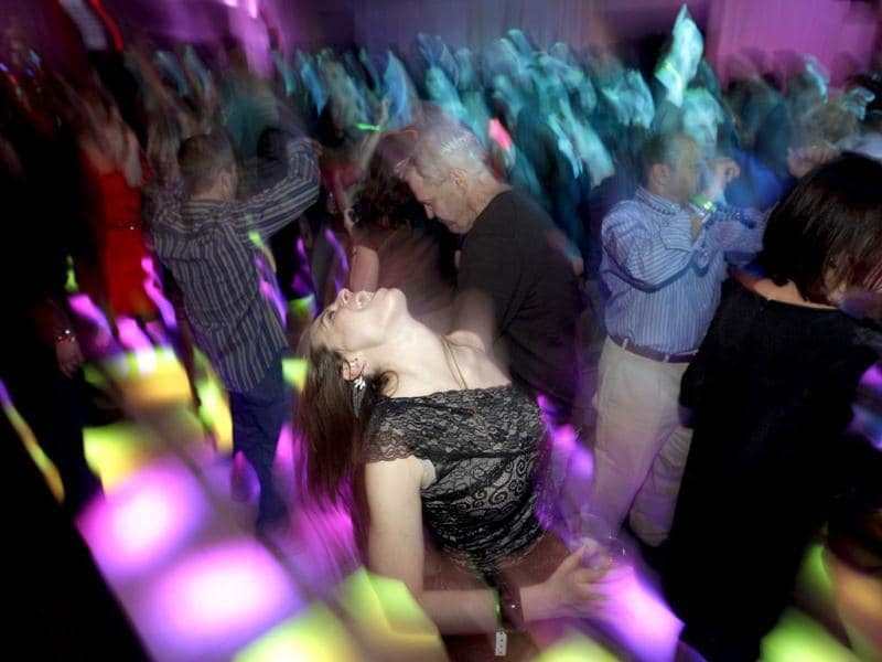 Party goers dance at the annual Leather and Laces event during Super Bowl XLVI festivities in Indianapolis. The New England Patriots are scheduled to face the New York Giants in NFL football's Super Bowl on Feb. 5. (AP Photo/Matt Slocum)
