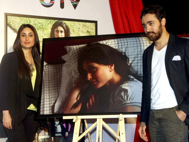 Kareena and Imran pose next to the canvas.