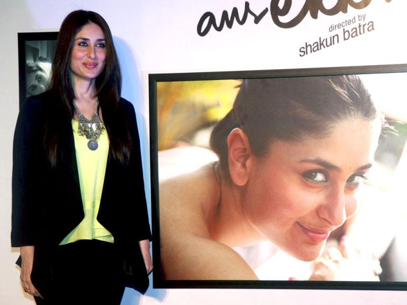 Kareena poses with her picture at the exhibition.