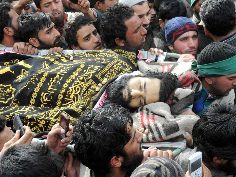 Kashmiri Muslims carry the dead body of Ashiq Ahmed Shah, a suspected militant of Lashkar-e-Taiba, during his funeral procession in Panzgham some 52 kilometres south of Srinagar. AFP Photo
