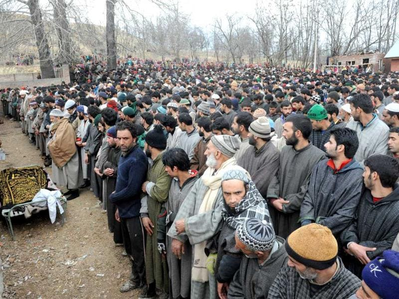 Kashmiri Muslims offer funeral prayers during the funeral procession of Ashiq Ahmed Shah, a suspected militant of Lashkar-e-Taiba, in Panzgham some 52 kilometres south of Srinagar. AFP Photo