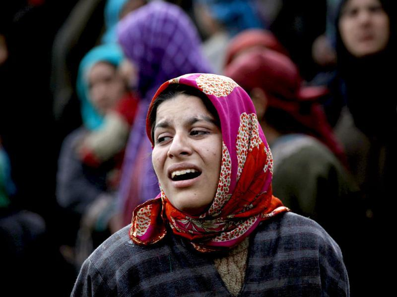 A woman reacts after seeing her house damaged in a gunbattle in Woodder village, some 41 kilometers south of Srinagar. AP Photo