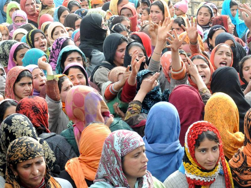 Kashmiri women shout anti-Indian slogans during the funeral procession of Ashiq Ahmed Shah, a suspected LeT militant, in Panzgham some 52 kilometres south of Srinagar. AFP Photo