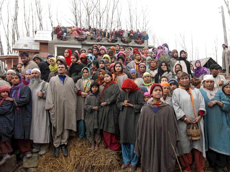 Kashmiri villagers watch the funeral procession of Ashiq Ahmed Shah, a suspected militant of Lashkar-e-Taiba, in Panzgham some 52 kilometers south of Srinagar. AP Photo