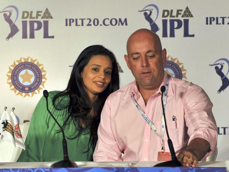 Owner of Deccan Chargers Gayathri Reddy with team coach Darryl Lehman during a press conference at the players' auction for the fifth edition of the Indian Premier League (IPL) cricket in Bangalore. AFP PHOTO/Manjunath Kiran