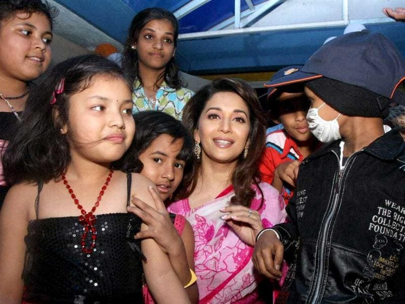 Bollywood actress Madhuri Dixit Nene interacts with cancer affected children on World Cancer Day in Mumbai. PTI
