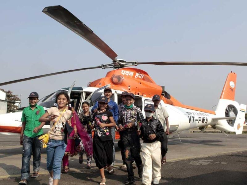 Cancer survivors taken on a chopper ride on ocassion of World Cancer Day in Mumbai. HT/Kalpak Pathak