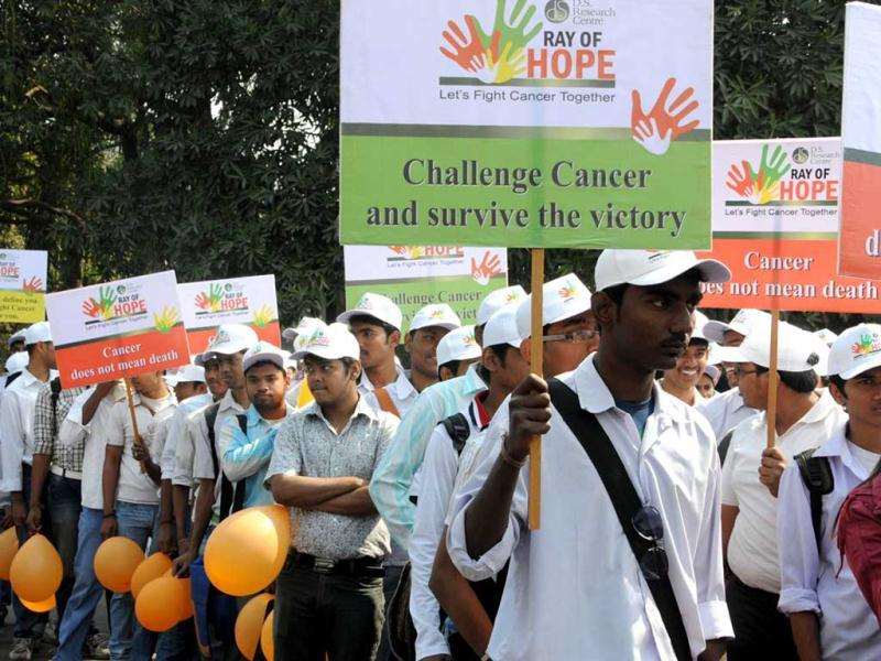 Participants at a walkathon on World Cancer Day to spread awareness against the deadly disease in Kolkata.