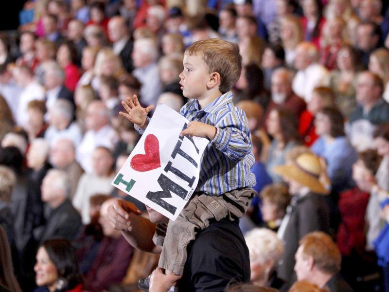 A boy holds up a sign supporting US Republican presidential candidate and former Massachusetts governor Mitt Romney at his Nevada caucus night rally in Las Vegas, Nevada. Reuters/Brian Snyder