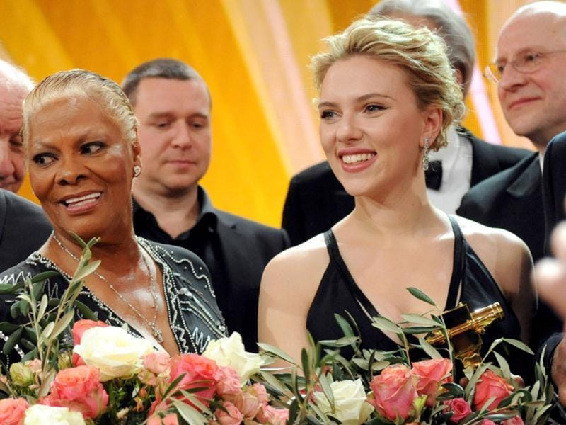 US singer Dionne Warwick (L) and US actor Scarlett Johansson appear on stage after the 47th Golden Camera award ceremony in Berlin. Reuters/Maurizio Gambarini/Pool